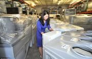 Advantix President Hannah Granade inspects some of the company's units at its North Miami Beach warehouse.