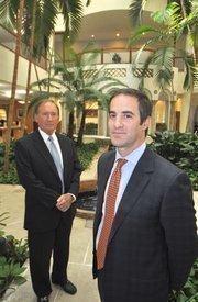 Apollo Bank President and CEO Richard Dailey and Chairman Eddy Arriola.