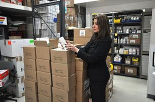 American Biologicals' Karen Moody reviews inventory at the company's warehouse.