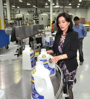 Zuliana Navarro, general manager of the Opa-locka facility, inspects products.