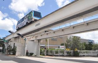The Metromover drives by the Miami Herald building, which now belongs to Genting.