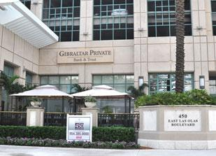 Gibraltar Private Bank & Trust, whose Fort Lauderdale office is shown, had an $11 million tax loss in the second quarter.