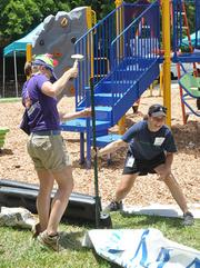 Ariel Fortune of Kaboom and Lynne Kunins of Humana help finish the playground.