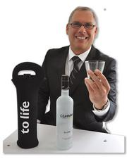 Ralph Mizraji, CEO of L'Chaim Kosher Vodka, with his uniquely branded beverage.