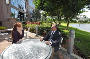 Kelly Trahan, property manager, with Alex Blochtein, president of Emerson Network Power Latin America, at Lake Shore Plaza II in Sunrise.