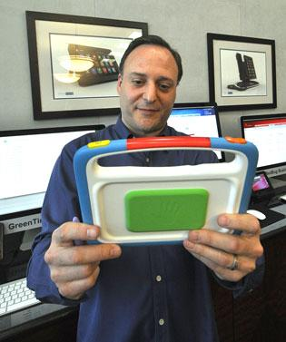 OpenPeak CEO Dan Gittleman holds one of the company's products for children.