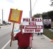 Jerry Buechler protests at the Pain Relief Centers of South Florida.