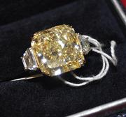 This 12.08 carat yellow diamond ring is one of several diamonds that Scott Rothstein bought with his Ponzi scheme proceeds.