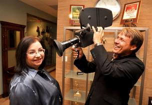 Tropic Survival founder and COO Sheila Duffy-Lehrman and Jim Knutt, its CEO, president and senior creative director, show the first camera they used.
