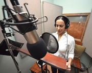 Elana Eli works on a production in Tropical Survival's sound booth.