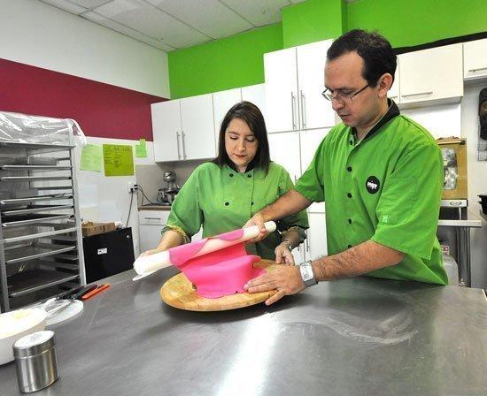 Carolina Montoya and Fernando Puga create one of their culinary masterpieces.