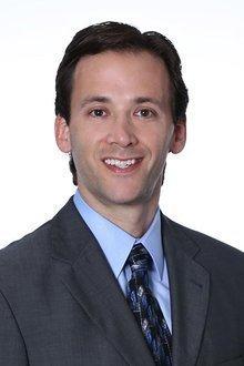 Adam D. Lustig