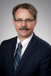 John W. Newcomer, M.D.
