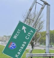 High winds during Friday's storms damaged road signs around Lambert airport.