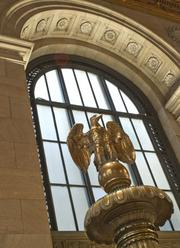 "The top of one of the original massive bronze information boards in the Great Hall - staff calls them the ""Eagle Standards."""