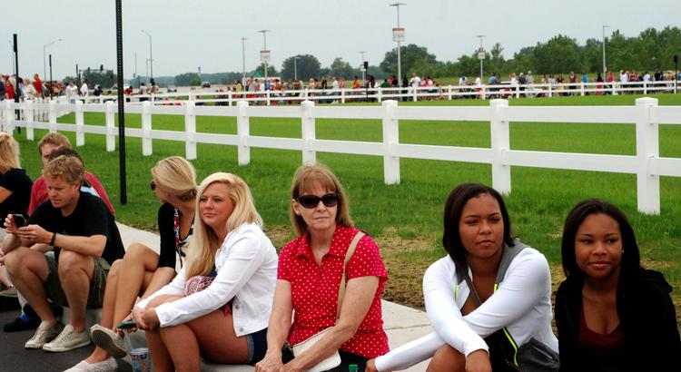 Shoppers wait in line Friday for the grand opening of Taubman Prestige Outlets in Chesterfield.