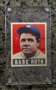 A baseball card of Babe Ruth.