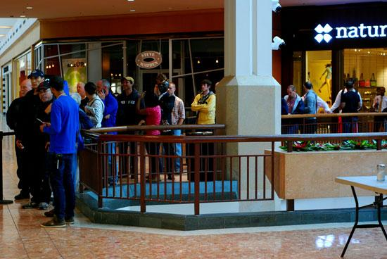 People wait in line in front of the Apple store at the Saint Louis Galleria this morning to get their hands on the iPhone 5.
