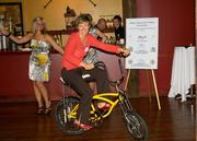 Carrie Cash of Team Revolution rides a bike at the event on Feb. 23.