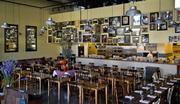 """Craft's newly opened restaurant, Pastaria in Clayton features warm colors, a wall full of family photos and exposed duct work. When designing Pastaria, Craft said they decided to go with concrete floor instead of wood floors. """"We didn't want families to feel bad if they spilled on the floor."""""""