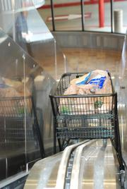 """The """"cartolator"""" moves carts from the main level to the garage."""