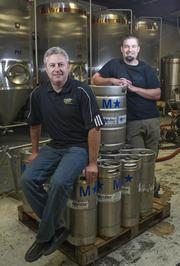 Jim Gorczyca (left), the new majority owner of O'Fallon Brewery and Brian Owens, the brewmaster.