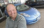 Steve Hughes, sales consultant for Lou Fusz Automotive, with the Nissan Leaf.