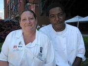 Michelle Kennon and John Robinson Jr., concession catering cooks for Delaware North Sportservice at Busch Stadium