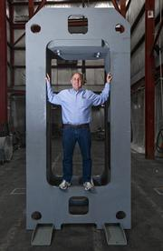 John Murphy inside the frame of a 20-ton press at his family's Neff Press, which is spending about $1 million to expand the hydraulic press maker's facilities in north county.