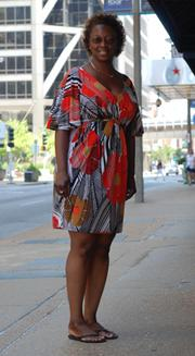 """Erica Ray is a records management clerk at the Federal Reserve Bank of St. Louis.Ray said she wore heels to work, but changed into flip flips to run errands over the lunch hour. She said the heat was """"out of control. Yesterday I didn't come out of the bank at all."""""""