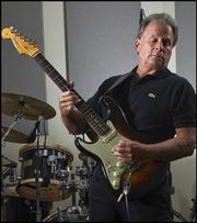 Gary Rich, this week's St. Louis Character, partnered with Carlos Santana on a shoe line bearing the rock star's name while Rich was an executive with Brown Shoe. Santana later invited him to play with the group.