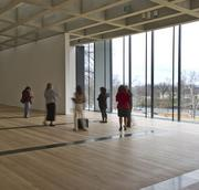 The building's floor-to-ceiling windows bring in natural light. Each window is outfitted with special shades to direct light at all times of the day and to protect art from light, temperature and humidity.
