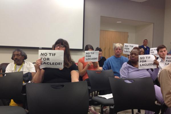 Protestors from Take Back St. Louis attend Wednesday's commission hearing.