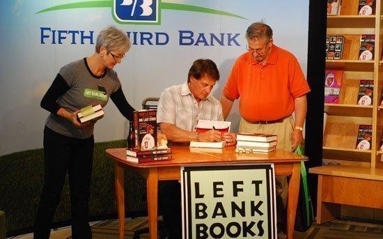Tony La Russa signs a copy of his memoir for a fan.