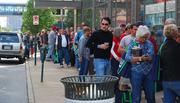"""A crowd lines up outside Left Hand Books downtown to buy Tony La Russa's memoir, """"One Last Strike."""""""