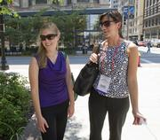 """Alice Pierce, left, and Bonnie Virag, both masters students in physical therapy at the University of North Carolina Chapel Hill, were also in town for the National Athletic Trainers Association conference.They didn't mind the heat.""""It's not humid here,"""" Virag said."""