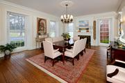Woodlawn: The dining room features a Colonial fire place, double hung windows with tuck away shutters and five-piece crown molding.