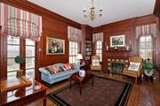 Woodlawn: The study features a custom painted tile hearth. French doors open to the rear covered terrace.