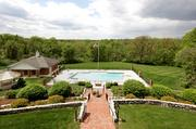 Woodlawn: An Olympic-size swimming pool with a pool house sits to the rear of the house.