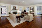 Woodlawn: The living room features French doors, a prominent fireplace and hardwood floors.