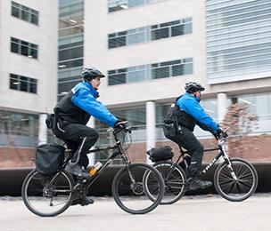 Two Barnes-Jewish Hospital security guards patrol the Washington University Medical Center campus. Additional bike patrols are one of several steps taken in recent years to increase security on the medical center campus.