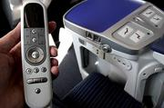 Business class on the 787 Dreamliner features a hand-held controller, USB power adapter, power outlet and power reclining seats.