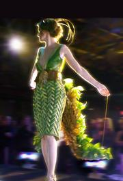 The bodice of the dress was woven in a herringbone pattern; dried leaves were fashioned into a belt.