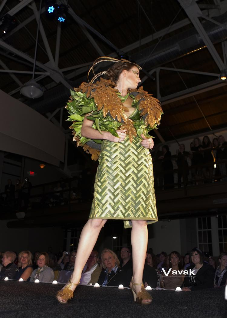 Christner's Emily Wray models a dress fashioned from foliage, dried leaves and living plants.