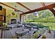 Huntleigh: The home has an outdoor living room and fireplace.