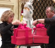 Macy's workers made sure every detail down to the tie of the bow was ready for the symphony's Holiday Celebration.