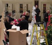 Eight Macy's workers unload materials and decorations in order to transform Powell Hall into a winter wonderland.