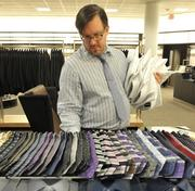 A Nordstrom employee lays out ties.