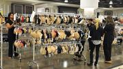 Nordstrom employees get merchandise ready for next week's opening.