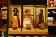 The store includes limited-edition merchandise, including princess dolls.